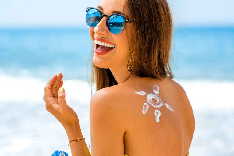 Woman using sun cream